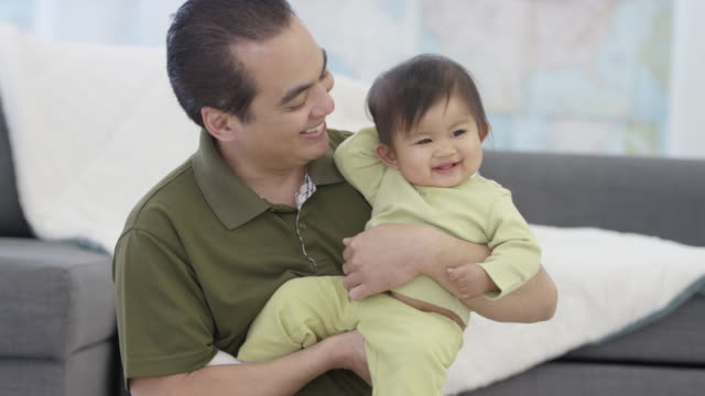 father and baby - genderblend stock videos & royalty-free footage