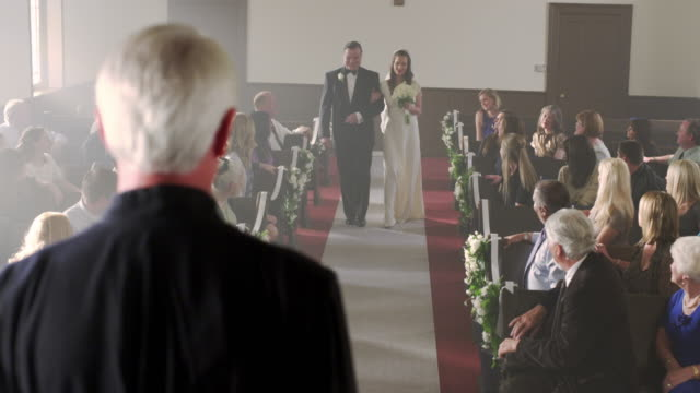 father and bride at front of chapel without a groom. - father of the bride stock videos and b-roll footage