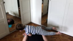 Father and child exercising at home