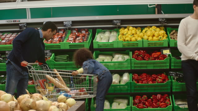 father and child shopping in produce department - shelf stock videos and b-roll footage