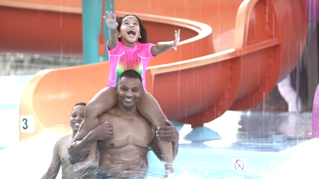 Father and children having fun at water park