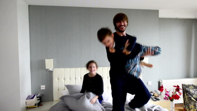 father and children having fun in the morning - bedroom stock videos & royalty-free footage