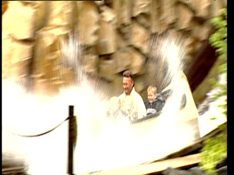 father and children on water log ride at amusement park denmark - two generation family stock videos & royalty-free footage