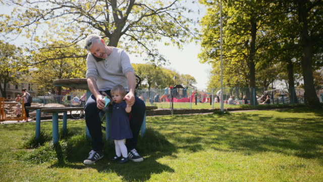 father and daughter at the park - role reversal stock videos & royalty-free footage