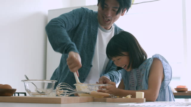 father and daughter baking together - japanese ethnicity stock videos & royalty-free footage