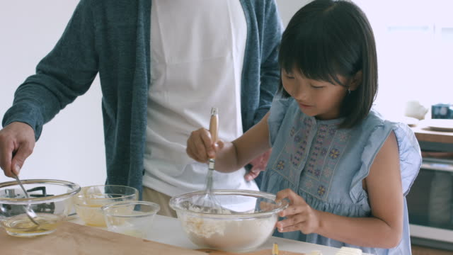 father and daughter baking together - domestic kitchen stock videos & royalty-free footage