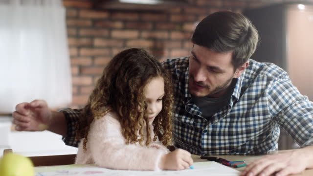 father and daughter coloring together - crayon stock videos & royalty-free footage
