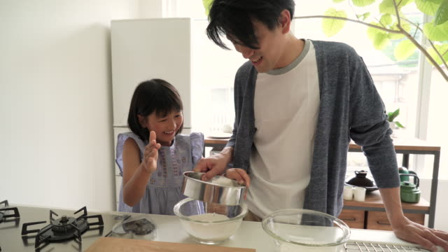 father and daughter cooking together in the kitchen - oven mitt stock videos and b-roll footage