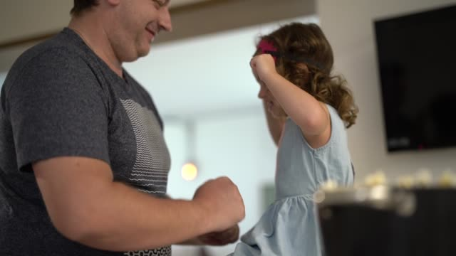 father and daughter dancing and having fun at home - toddler stock videos & royalty-free footage