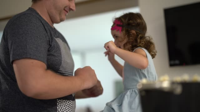 father and daughter dancing and having fun at home - heroes stock videos & royalty-free footage