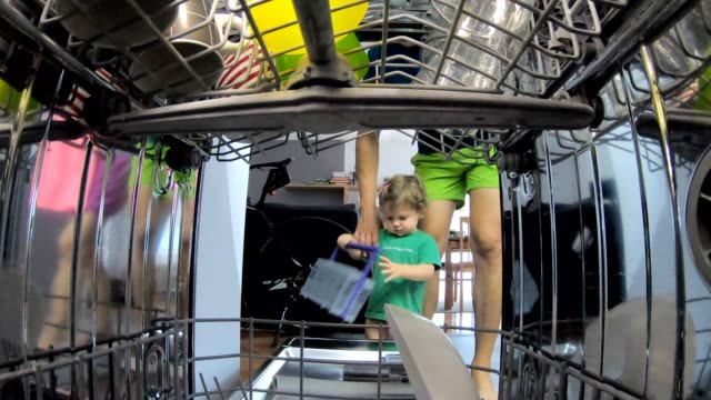 father and daughter doing domestic chores in kitchen - housework stock videos & royalty-free footage
