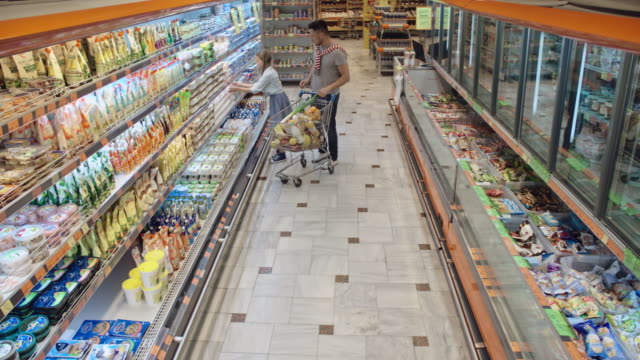 Father and daughter doing food shopping together