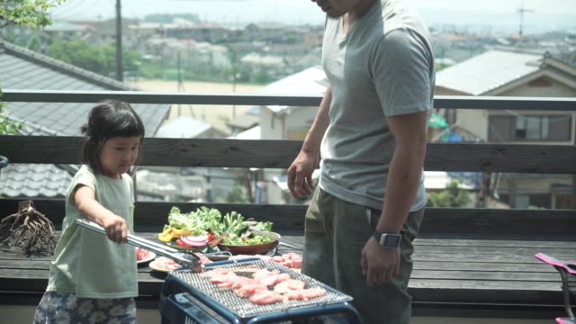 father and daughter enjoying a barbecue on the terrace - only japanese stock videos & royalty-free footage