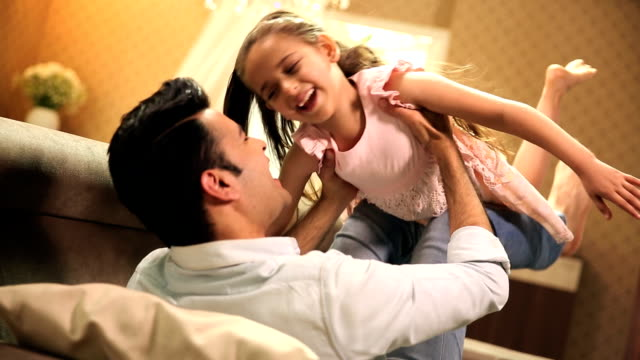 Father and daughter enjoying at home, Delhi, India