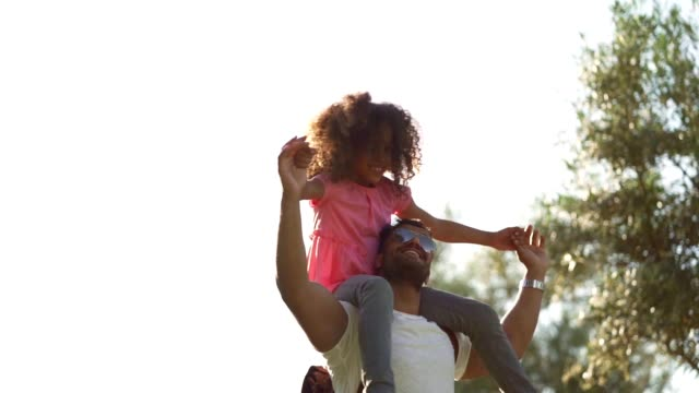 father and daughter enjoying summer day in the park - carrying on shoulders stock videos & royalty-free footage