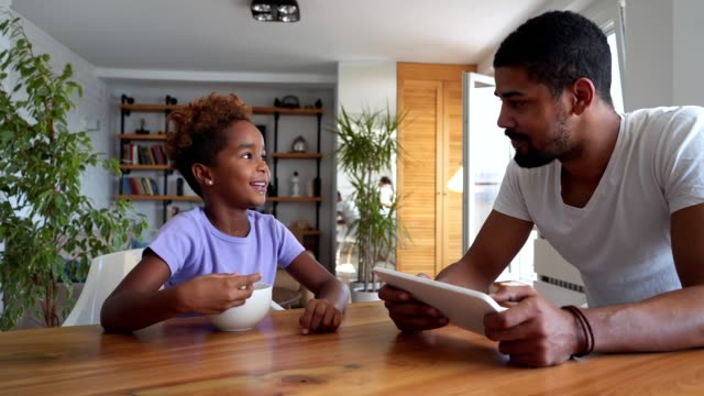 father and daughter enjoying their time together at the dinning table - dairy product stock videos and b-roll footage