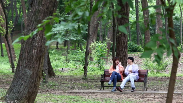 Father and Daughter have a talk at the Seolleung(Tomb of the Joseon Dynasty King) Park in Seoul City