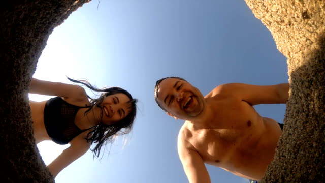 father and daughter having fun at beach - hole stock videos & royalty-free footage
