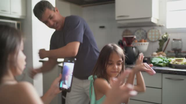 father and daughter in the kitchen filming while dancing - home interior stock videos & royalty-free footage