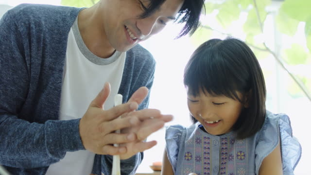 Father and Daughter Making Cake Together in Japanese Home Kitchen