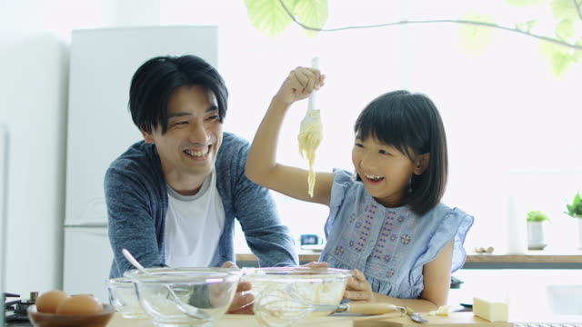 father and daughter making cake together - single father stock videos & royalty-free footage