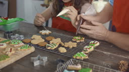 SLO MO Father and daughter making Christmas cookies together at kitchen counter