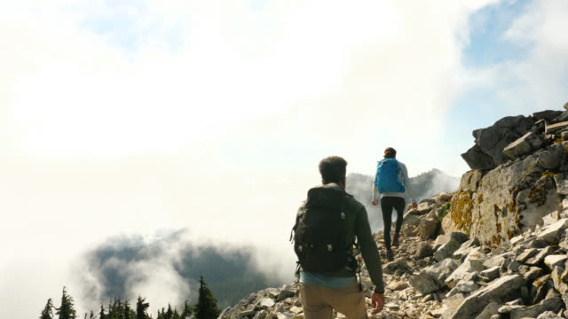 ms father and daughter on hike together in mountains - direction stock videos & royalty-free footage