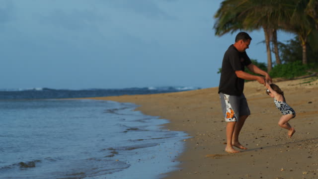 father and daughter on the beach - tropical climate stock videos & royalty-free footage
