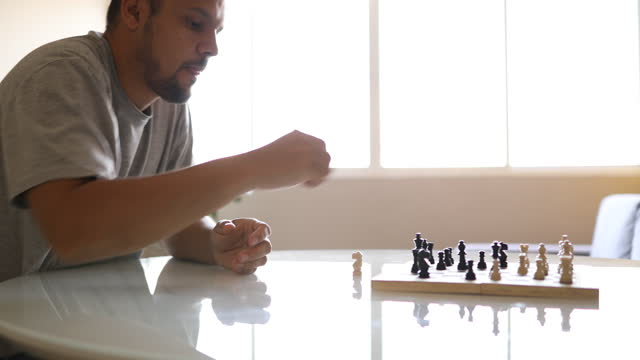 father and daughter playing chess - dia stock videos & royalty-free footage