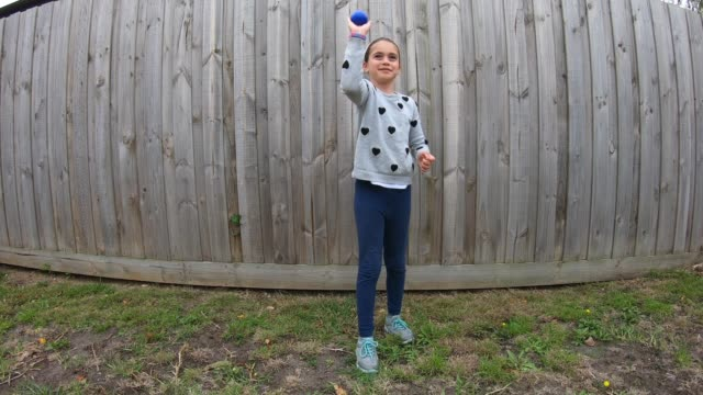 father and daughter playing with a ball in the backyard - throwing stock videos & royalty-free footage