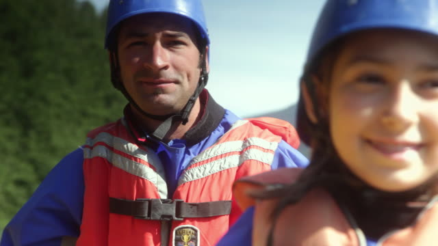 cu father and daughter (10-11) rafting through rapids in squamish river forest / squamish, british columbia, canada - inflatable raft stock videos & royalty-free footage