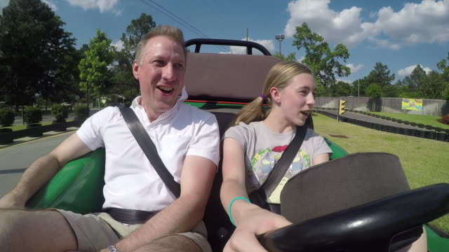 father and daughter riding a go cart - go cart stock videos & royalty-free footage