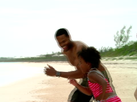 ms,  father and daughter (8-9 years) running into sea,  harbour island,  bahamas - 8 9 years stock videos & royalty-free footage