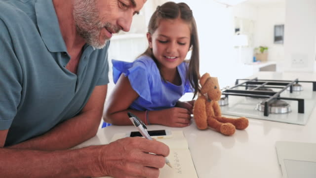 father and daughter solving equation - western script stock-videos und b-roll-filmmaterial