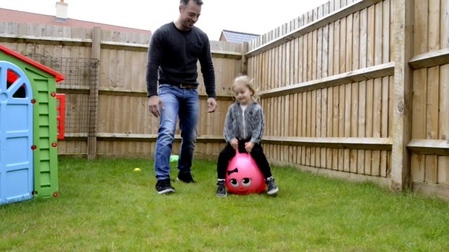 father and daughter spending free time together - domestic garden stock videos & royalty-free footage