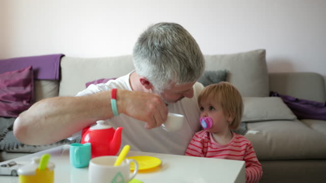 father and daughter teatime - role reversal stock videos & royalty-free footage