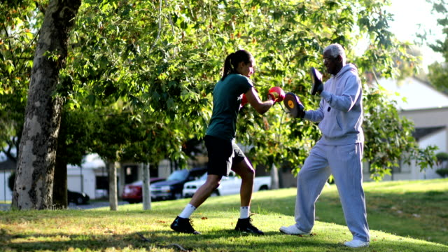 father and daughter training - boxing sport stock videos and b-roll footage
