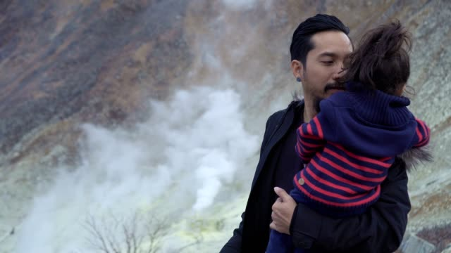 father and daughter traveling to see volcanic smoke - randoseru stock videos & royalty-free footage