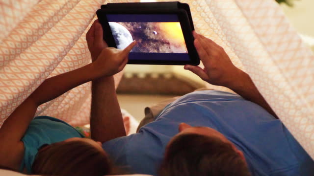 father and daughter using digital tablet. - sheet stock videos & royalty-free footage