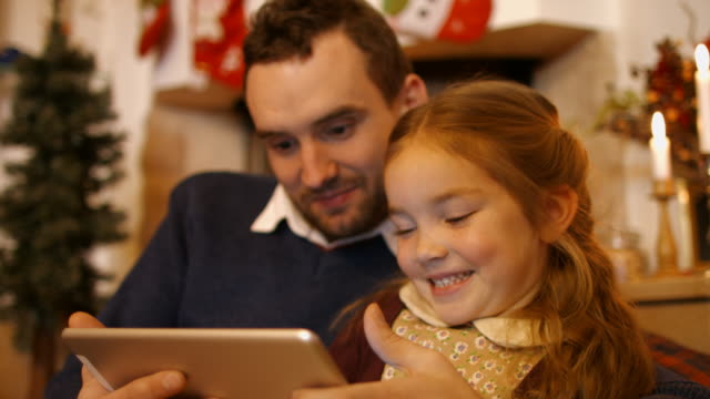 father and daughter using tablet computer - choosing stock videos & royalty-free footage