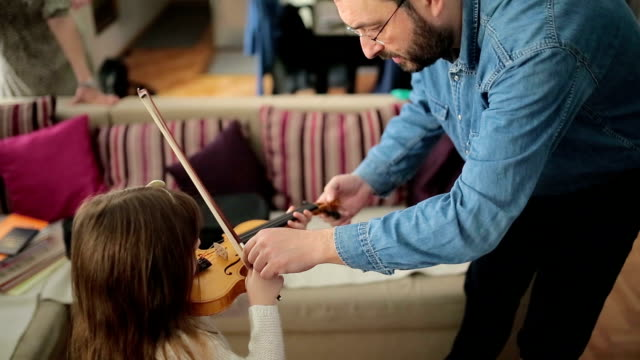 Father and daughter violin lesson