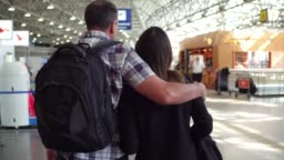 Father and Daughter walking on the airport