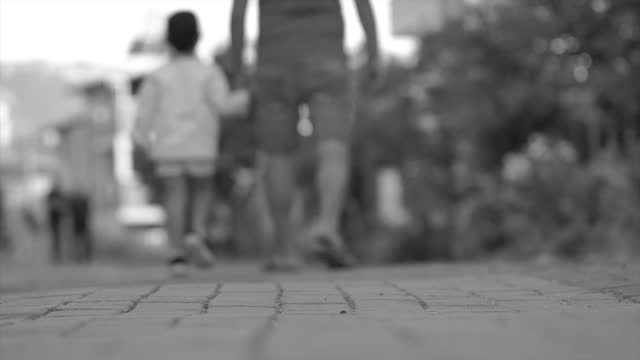 father and daughter walking rear view - cobblestone stock videos & royalty-free footage