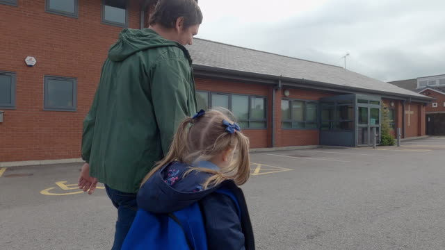 father and daughter walking to school - walking stock videos & royalty-free footage