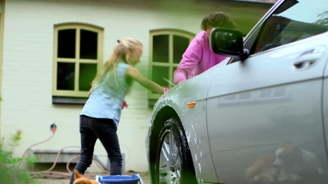 father and daughter washing car - washing stock videos & royalty-free footage