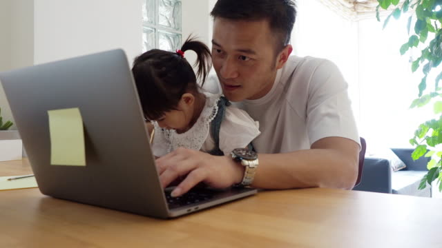 father and daughter working together at home - two generation family stock videos & royalty-free footage