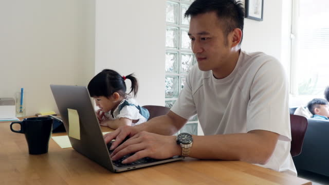 father and daughter working together at home - home office stock videos & royalty-free footage