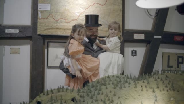 father and daughters looking at model trains - top hat stock videos & royalty-free footage