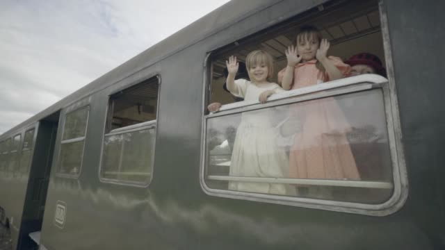 father and daughters waving out of an old steam train car - top hat stock videos & royalty-free footage