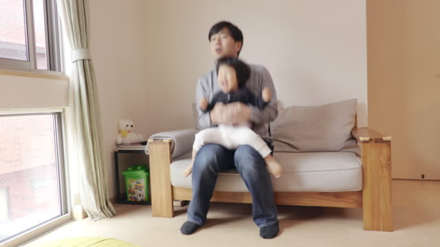 Father and daughterto play while watching TV